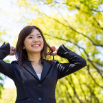 young asisn businesswoman in the park