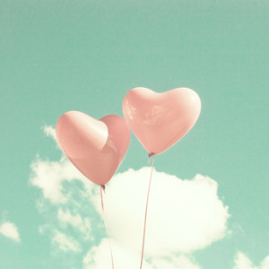 Two pink heart-shaped balloons